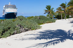 Cruise ship and palm tree shadow at Grand Turk Stock Photos