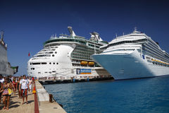 Cruise Ship Passengers. Two Huge Cruise ship s dock in Cozumel, Mexico and passengers disembark Royalty Free Stock Image