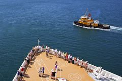 Cruise ship passengers on the deck arriving in Caribbean port Stock Photography