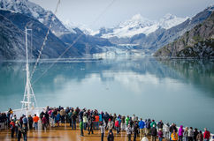 Cruise ship passengers in Glacier Bay National Park. GLACIER BAY, ALASKA SEPTEMBER 11, 2016 Cruise ship passengers get a close-up view of the majestic glaciers Royalty Free Stock Photos