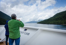 Cruise ship passengers look out for marine life Royalty Free Stock Photography