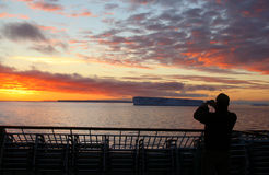 Cruise ship passengers taking pictures of sunset Stock Image