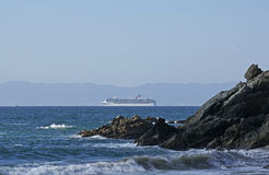 A cruise ship passing off the coast of Puerto Vallarta Mexico Royalty Free Stock Images