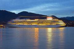 Cruise Ship. A passing cruise ship photographed with an intentional blur shows the beauty of its evening lights Royalty Free Stock Photos