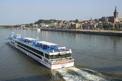 Cruise ship passing skyline city Nijmegen Royalty Free Stock Image