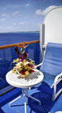 Cruise ship patio deck. Cruise ship liner patio deck with chair and table stock images