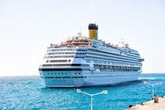 Cruise ship on philipsburg, sint maarten coast. Ocean liner in blue sea on sunny sky. Water transport and vessel. Luxury travel by Royalty Free Stock Image