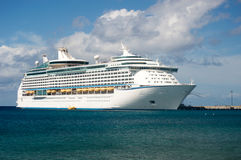 Cruise ship at pier in Caribbean Islands. Large cruise ship at pier in Caribbean Islands on cloudy day with blue skies and blue water Stock Photos