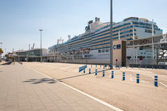 Cruise ship at the pier in the marina Port Vell Stock Photos