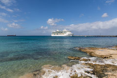 Cruise Ship and Pier Past Rocky Shore. White Luxury Cruise Ship Docked at St Croix Royalty Free Stock Photos