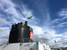 Cruise ship and plane, Norway. Stock Photography