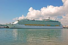 Cruise ship in port. Giant cruise ship loading passenger at port of call Stock Images