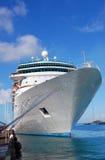 Cruise Ship at Port. White cruise ship docked at port Stock Photo