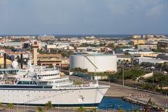 Cruise Ship in Port of Aruba. White Luxury cruise ship in port in Aruba Stock Image