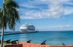 Cruise ship in port at Frederiksted, St. Croix, US Virgin Islands. View from the Fort Frederik cannon area Stock Photos