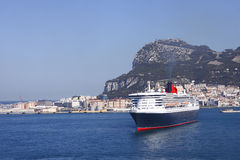 Cruise ship in port Gibraltar. Cruise ship bow  in port with built up background of Gibraltar and the famous Rock Royalty Free Stock Image