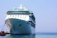 Cruise ship in port. Huge ocean liner docked in port Stock Photos