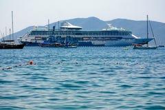Cruise ship in port. Huge ocean liner docked in port Stock Image