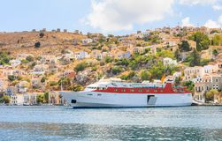 Cruise ship in the port of the island of Symi Royalty Free Stock Photography