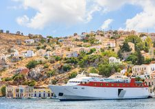 Cruise ship in the port of the island of Symi Stock Images
