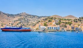 Cruise ship in the port of the island of Symi Stock Photo