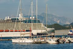 Cruise Ship in the Port of La Spezia - Liguria Italy. Luxury cruise ship in the port of La Spezia. In the background the Apuan Alps Alpi Apuane. Liguria, Italy stock images