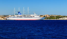 Cruise ship in the port of Rhodes, Greece sunny day view from the sea Royalty Free Stock Photos
