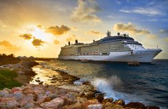 Cruise ship in port on sunset. Royalty Free Stock Photos