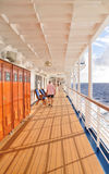 Cruise ship promenade deck. Senior man walking on the promenade deck of a cruise ship Stock Photo