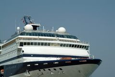 Cruise ship prow in harbor Stock Images