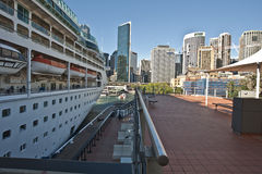 Cruise ship at the Quay. Looking down the side of the P&o Cruise Liner Rhapsody of the Sea tied up at Circular Quay Sydney looking back towards the city stock photos