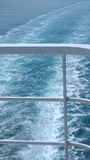 Cruise Ship Railings and Ocean Wake Royalty Free Stock Image
