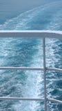Cruise Ship Railings and Ocean Wake Royalty Free Stock Image