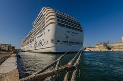 Cruise ship rear view panorama. Cruise ship rear view with thick ropes panorama Stock Image