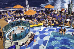 Cruise Ship - Relaxing by the Pool Stock Image