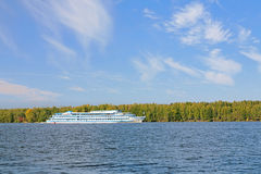 Cruise ship on a river in autumn sunny day Royalty Free Stock Images