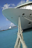 Cruise Ship with ropes. Front (bow) of a cruise ship tied up to the dock  with rope Stock Photo