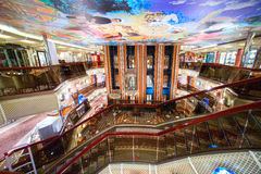Cruise ship's main lobby with different shops and bars around. Elevators go from 1-st up to 12-th deck. Stock Photos