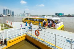 Cruise ship on Saigon river. HOCHIMINH CITY- VIETNAM: People getting off the cruise ship on Saigon river in Hochiminh city, Vietnam. This is a new communication Royalty Free Stock Photography