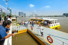 Cruise ship on Saigon river. HOCHIMINH CITY- VIETNAM: People getting off the cruise ship on Saigon river in Hochiminh city, Vietnam. This is a new communication Royalty Free Stock Images