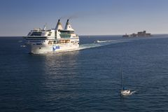 Cruise ship and sail boat sailing in Mediterranean Ocean, Europe Stock Image