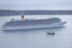 Cruise ship and sailboat in Santorini stock photography