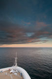 Cruise Ship Sailing At Sunset Stock Photo