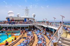 Cruise Ship Sailing on the Mediterranean. Mediterranean Sea - June 17, 2016:  Passengers aboard Royal Caribbean`s Brillance of the Seas relaxing by the pool Royalty Free Stock Photo