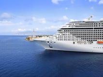 Cruise Ship sailing from port stock photos