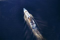 Cruise ship sailing on the sea.  Top view. Concept: of a journey by sea Stock Photography