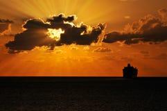 Cruise Ship Sailing Into Sunset Stock Photo