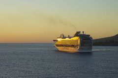 Cruise ship sailing into a sunset, Caribbean Royalty Free Stock Photography