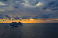 Cruise ship sailing  during the sunset. Royalty Free Stock Image