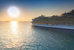 Cruise Ship Sailing at Sunset Royalty Free Stock Image